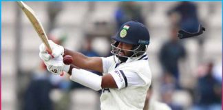 cheteshwar pujara misses a pull shot and gets hit straight on the helmet